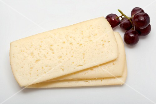 Esrom (semi-hard cheese from Denmark) and red grapes