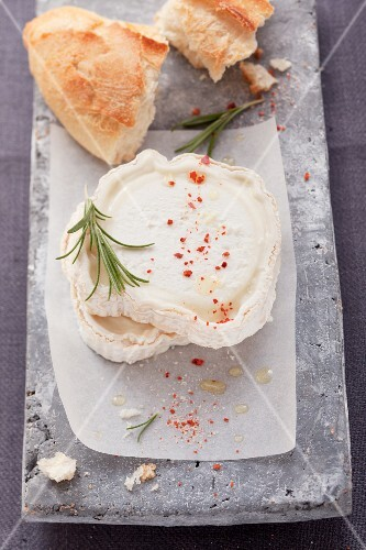 Goat's cheese with rosemary and a chunk of baguette