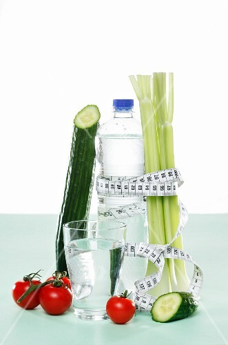 Vegetables and water with a measuring tape