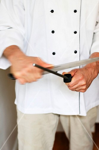 A Chef Sharpening a Knife