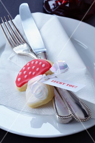 A toadstool-shaped biscuit with a message tag decorating a plate