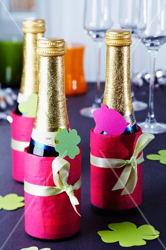 Piccolo bottles decorated with tissue paper and tags