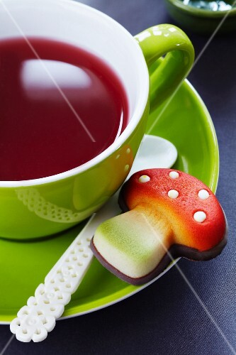 A marzipan toadstool with a cup of tea