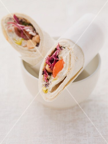 Wraps filled with houmous and tomatoes