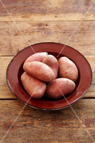 Red potatoes on an enamel plate