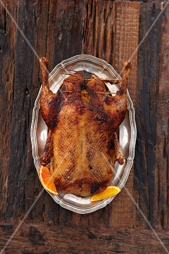Stuffed duck with orange wedges