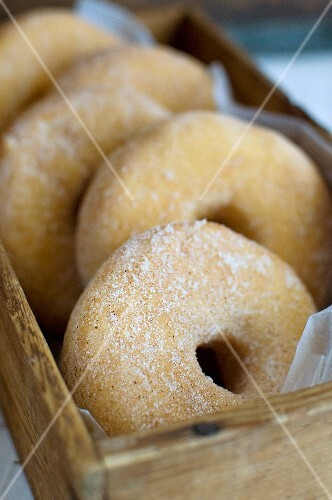 Plain doughnuts in a wooden box