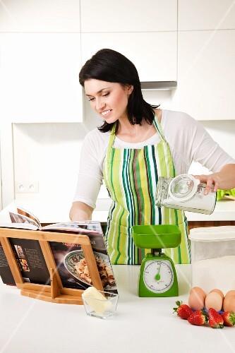 A woman making a strawberry cake