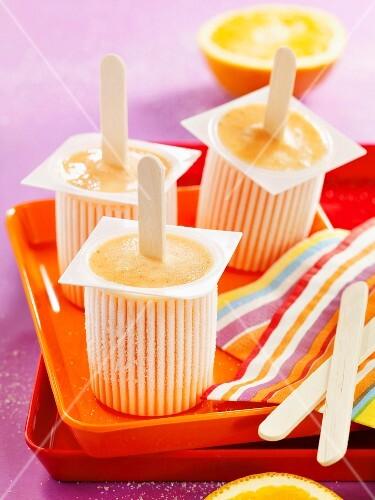 Home-made honey and orange ice lollies