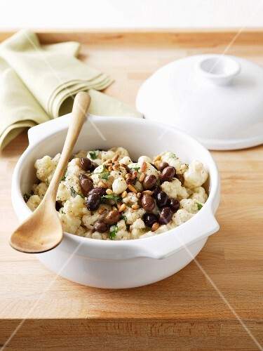Cauliflower salad with olives and pine nuts