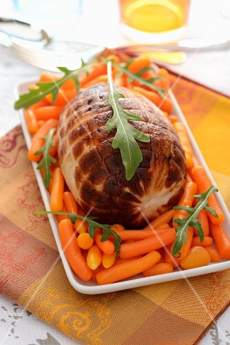 A rolled roast with carrots and rocket