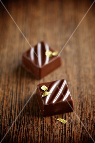 Thyme-filled chocolate squares with gold leaf