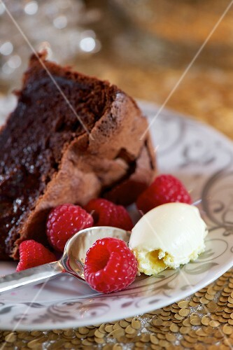 A slice of chocolate and raspberry cake