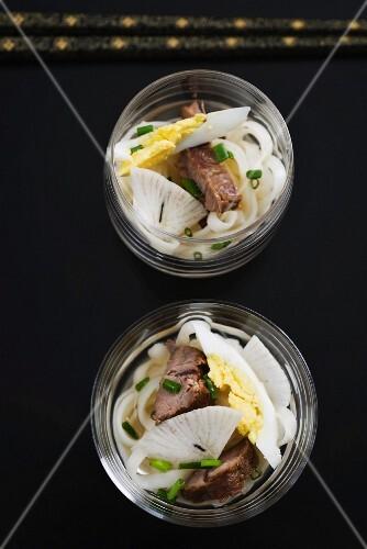 Ramen soup with noodles, radish, egg and braised pork (Japan)