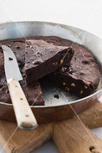 Chocolate and peanut butter cake, one slice cut