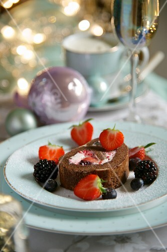 Chocolate Swiss roll with berries for Christmas