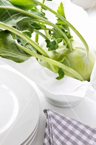 Kohlrabi in a bowl with paper