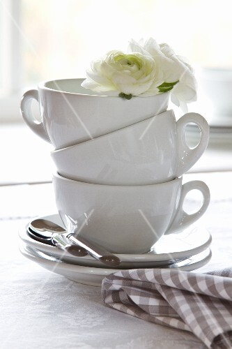 Stacked coffee cups decorated with white flowers