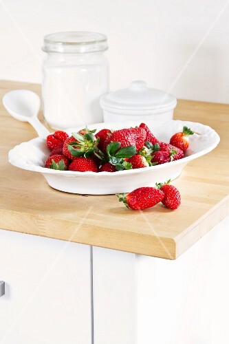 Fresh strawberries in a white porcelain bowl