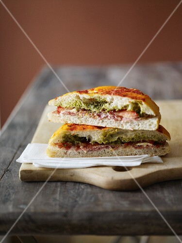 A sandwich with dry-cured ham, cut in half