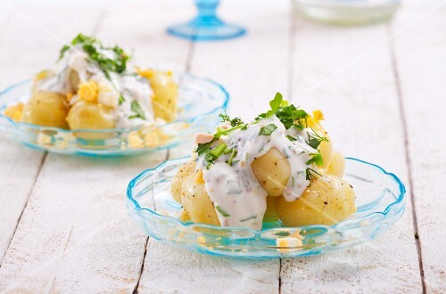 Potato salad with hard-boiled eggs, sour cream, fennel and chives