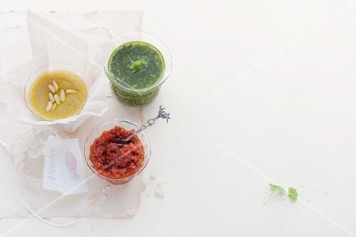 Pine nut pesto, parsley pesto and tomato pesto