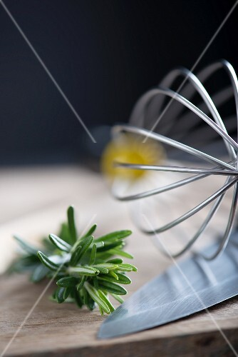 Fresh rosemary, an egg whisk and a knife