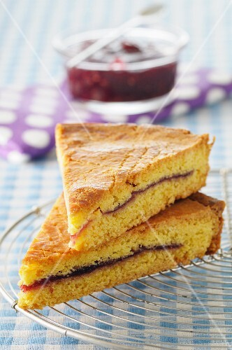 Two slices of gâteau basque (almond cake, France) with cherry jam