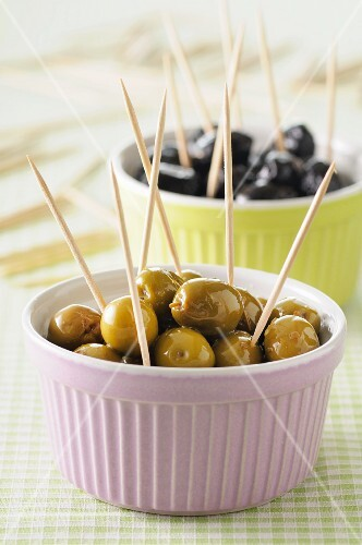 Green and black olives on cocktail sticks