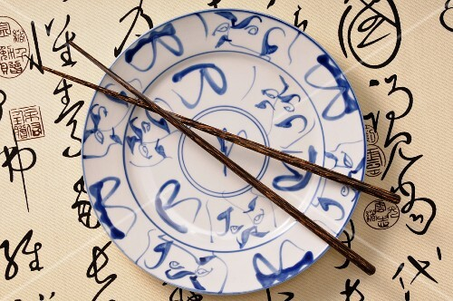 An Asian plate and chopsticks (view from above)