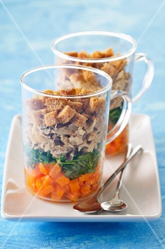 A layered starter with croutons and smoked mackerel