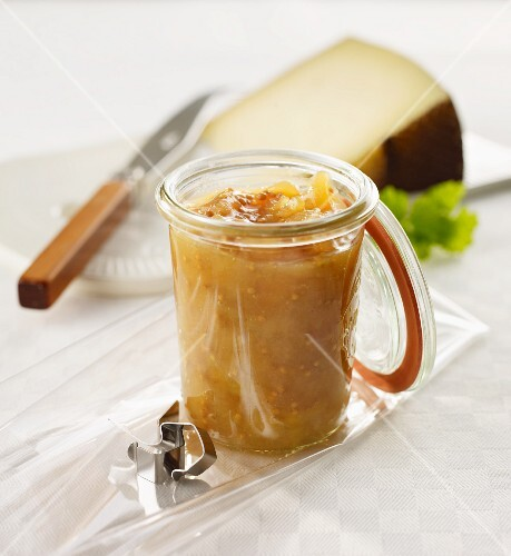 Pear mustard, a wedge of cheese in the background