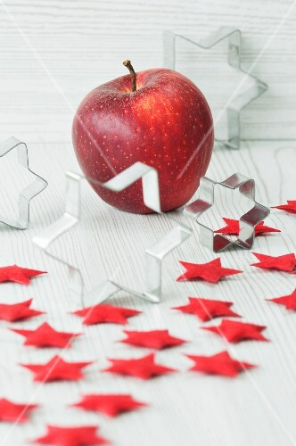 Christmas decorations, with cutters, red felt stars and an apple