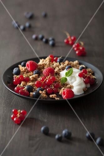Muesli with fresh berries and yoghurt