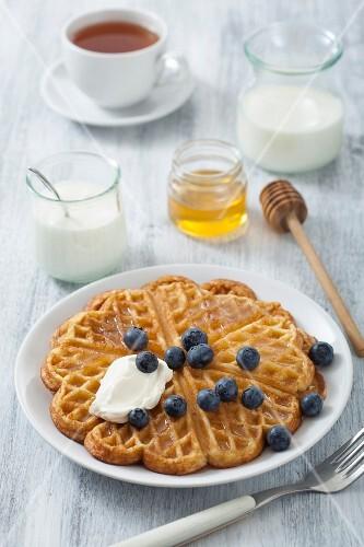 Waffle with blueberries, yogurt and honey