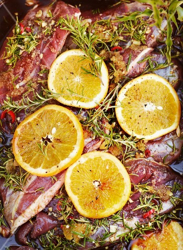 Marinated duck breast with oranges, rosemary, chilli, honey and garlic (close-up)