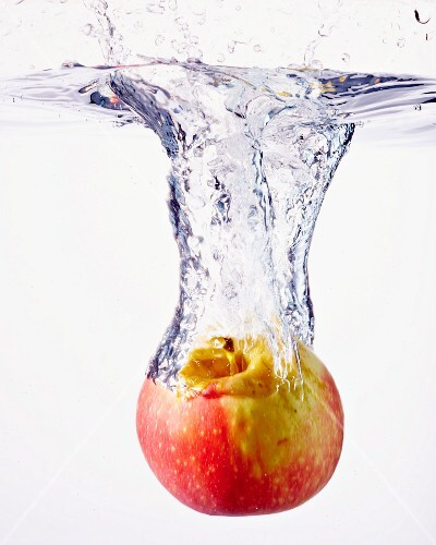 An apple falling into water