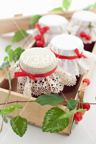 Jars of Homemade Cherry Jam in a Box