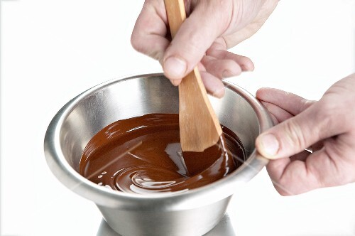 Melted chocolate being stirred