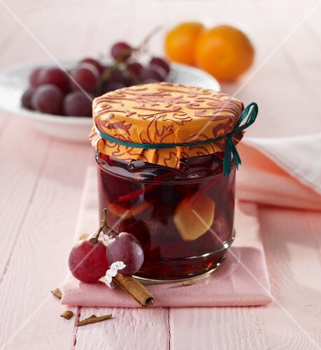 Blue grapes preserved in wine and Grappa