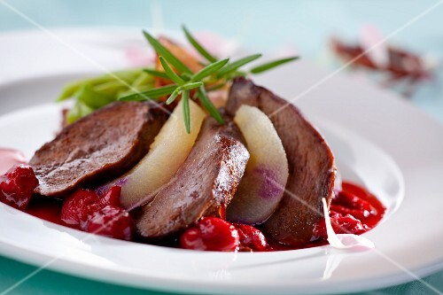Duck breast with pears, cherries and fresh rosemary