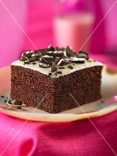 A piece of chocolate cake with chocolate biscuit topping