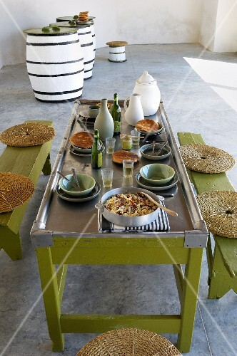 A table laid for a meal with couscous and olive oil (Tunisia)