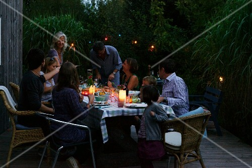 A family barbecue party on the patio in the evening