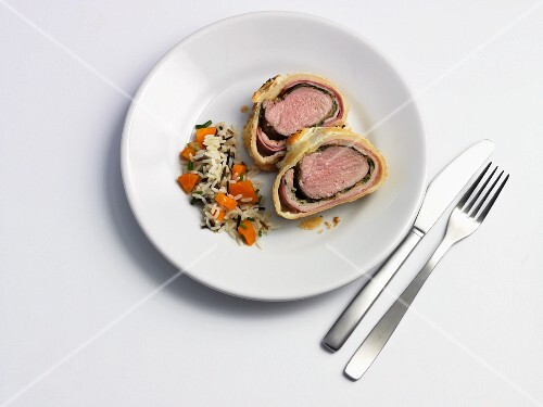 Pork fillet wrapped in puff pastry and served with rice