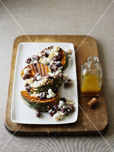 Salad with grilled squash wedges, feta cheese and olives