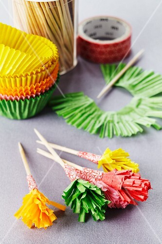 Frilly cocktail sticks made from paper cake cases