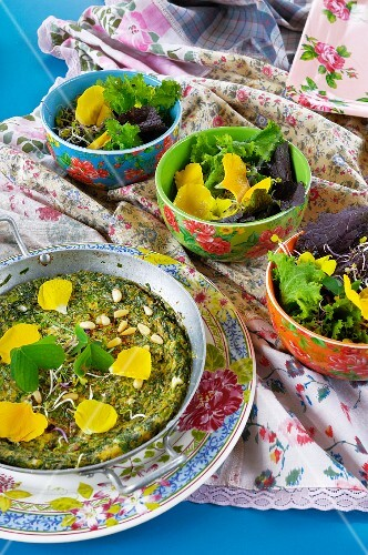 Herb omelette with pine nuts and edible flowers
