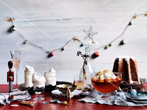 A Christmas dessert buffet with pandoro, blueberry pavlova and peach and prosecco jelly with mascarpone