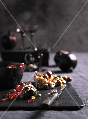 Chocolate truffles, pomegranate seeds and hazelnut brittle